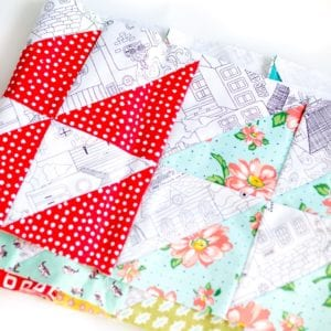 How-to-make-half-square-triangles-from-a-jelly-roll-using-the-strip-method-coral-and-co